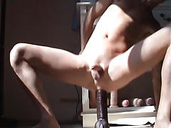 Twink fucks huge black dildo