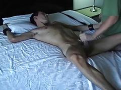 bound dude gets handjob