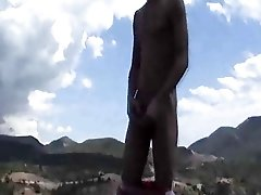 Twink jacks off in mountains
