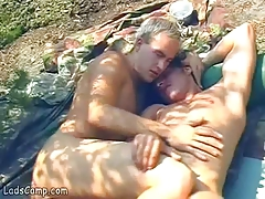 Nude gay sunbathers please each other in the rocks
